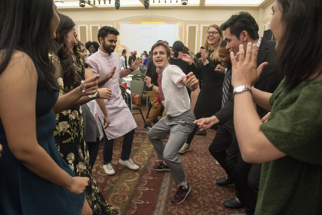 Ohio University community members dance with each other after the International Dinner during International Education Week. The International Dinner included food and performances from around the world. Photo by Hannah Ruhoff