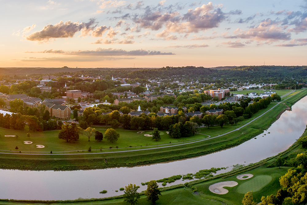 Aerial view of the Athens campus with the Hocking River on one side and rolling Appalachian hills on the other