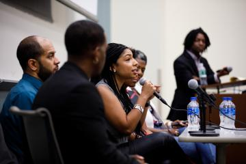 Alumni panelist Jennifer Moore, BSJ '07, speaks during the Alvin Adams Symposium.