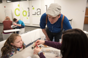 Students and their siblings participate in a remote control car building activity at the CoLab in Alden Library during Sibs Weekend on Feb. 2, 2019.