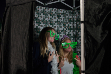 Two students pose for a photo in a photo booth at the 2016 Yell Like Hell Pep Rally.