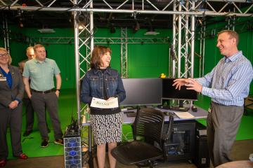 Cinematographer Matt Love (Right) talks with Anne Hazlett, Sr. Adviser For Rural Affairs about the virtual realty Narcan treatment they helped develop at the GRID Lab in the Scripps College of Communication at Ohio University.