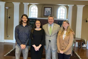 Students Eli Wanner, Katy Perani and Kate Fedderson pose with Chancellor Mike Duffey