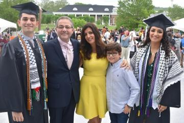 The Afyouni family poses outside the Convocation Center on graduation day for Nader, BBA '19, and Amal, BA '19.