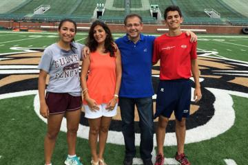 The Afyouni family is pictured on the field of Ohio University's Peden Stadium.