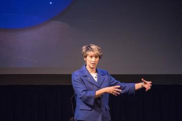 Eileen Collins speaking on stage