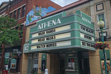 """Athena Cinema in Athens, with marquee reading """"Wash Hands - Wear Masks - Watch Movies"""""""