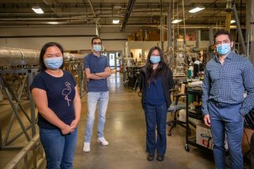 From left, graduate students Zhong Li, Payman Sharifi Abdar, Zheng Ma, and Fazlollah Madani Sani stand in the Institute for Corrosion and Multiphase Technology facility.
