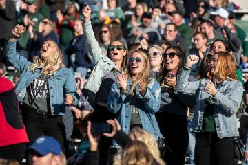 Fans cheer during Ohio University's Homecoming football game