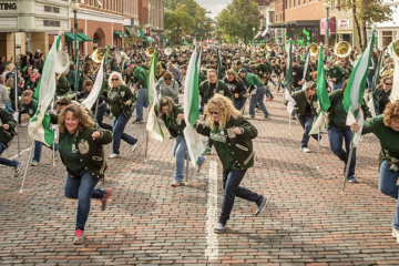 Marching 110 alumni performing in the Homecoming parade