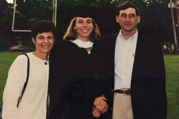 Ohio University graduates Betsy (Williams) Lancaster and Raymond Lancaster, pictured here at their daughter Christine's graduation, made a pact years ago to support their alma mater.
