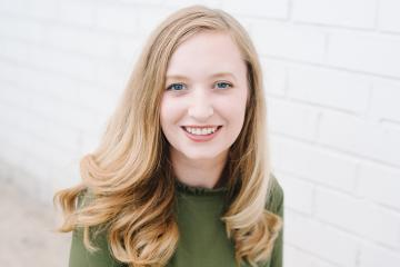 Pictured is a headshot of Emily Mullin.