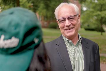 Ohio University President Hugh Sherman, who is featured on the cover of the fall 2021 issue of Ohio Today magazine, is pictured with a student on College Green.
